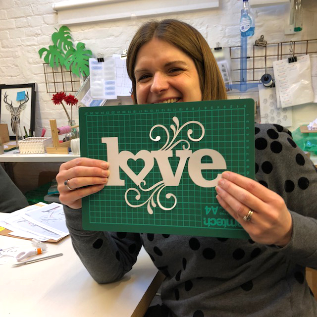 Clare completes the LOVE papercut