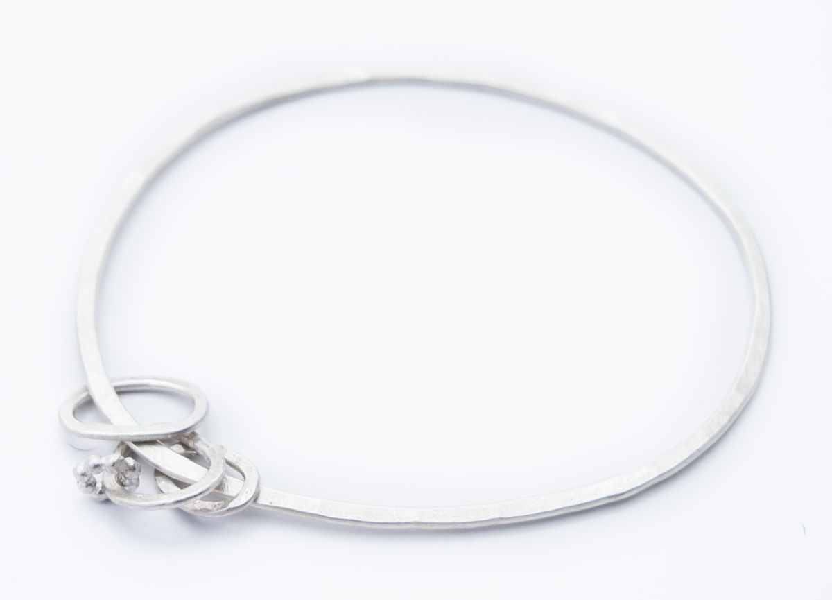 Oval charm eco-silver bangle - product image