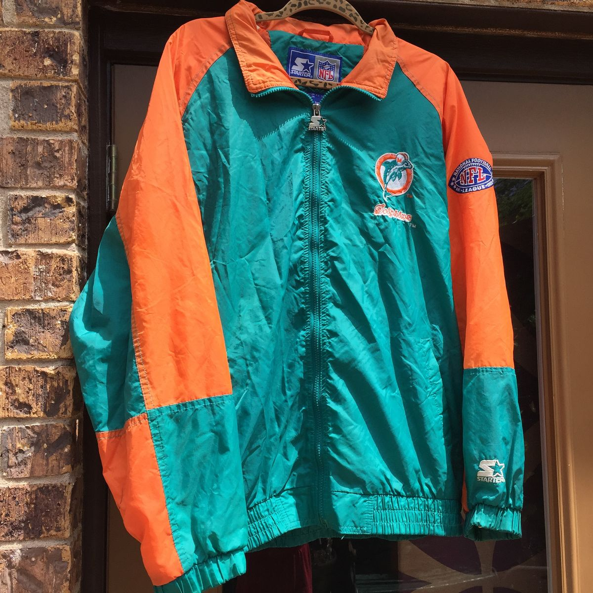 info for c7399 40dca Vintage 90s Miami Dolphins Windbreaker/Hoodie