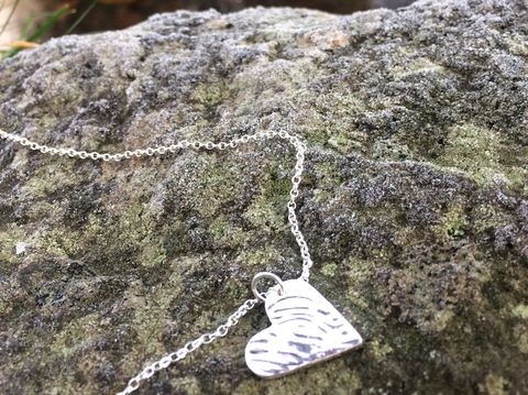 Silver,ripple,heart,pendant,and,necklace,Silver necklace, ripple charm, charity, donation