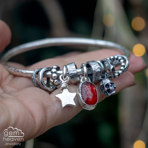 RESERVED,Spinner,of,Yarns,bangle,with,Garnet,charm bangle , charm bangle, Garnet, red gemstone, rustic silver, sterling silver, uk made, boho style, cornish jewellery, cornish jeweller, bohemian jewellery, gypsy style,