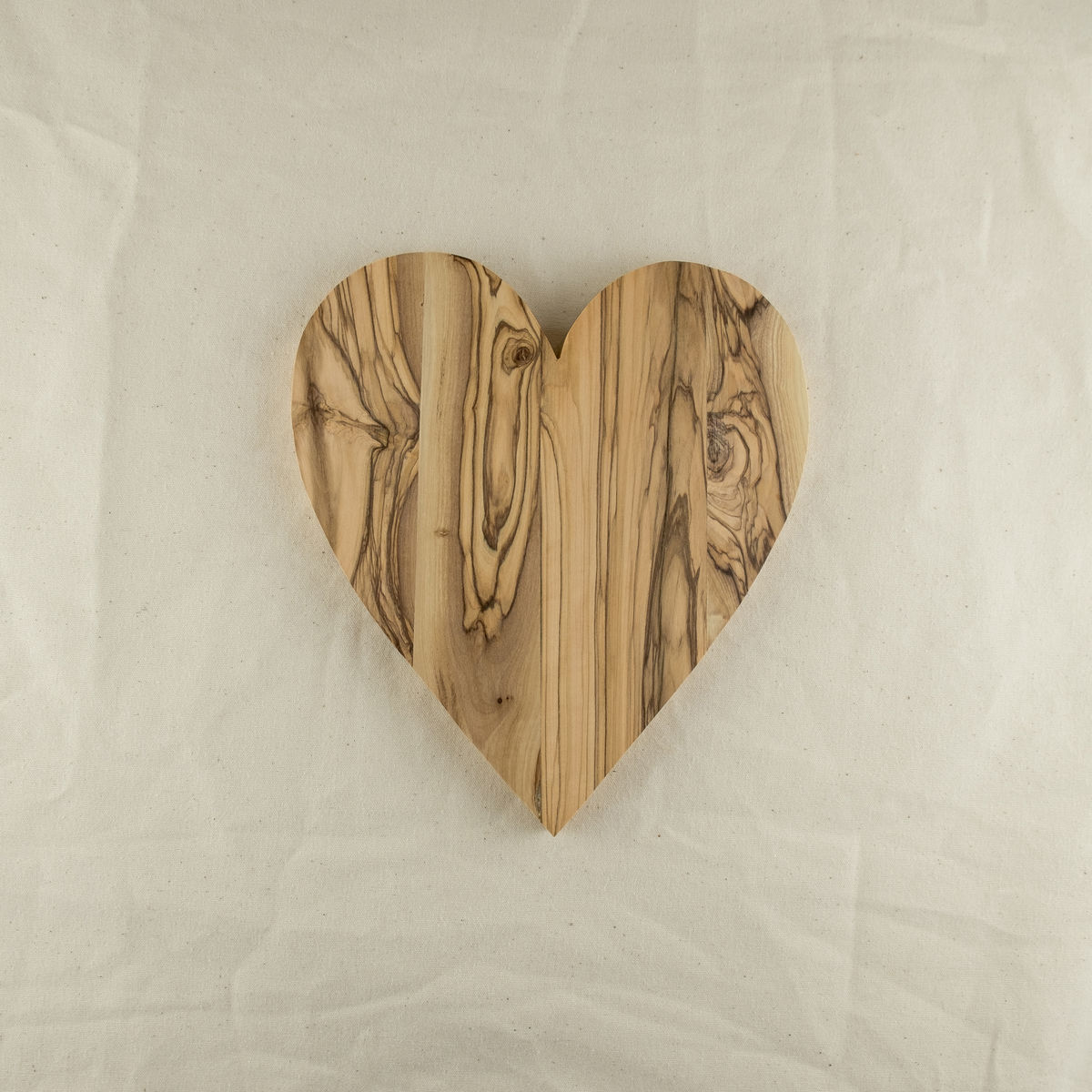 Olive wood heart shaped board - Handcrafted in Palestine - product images  of