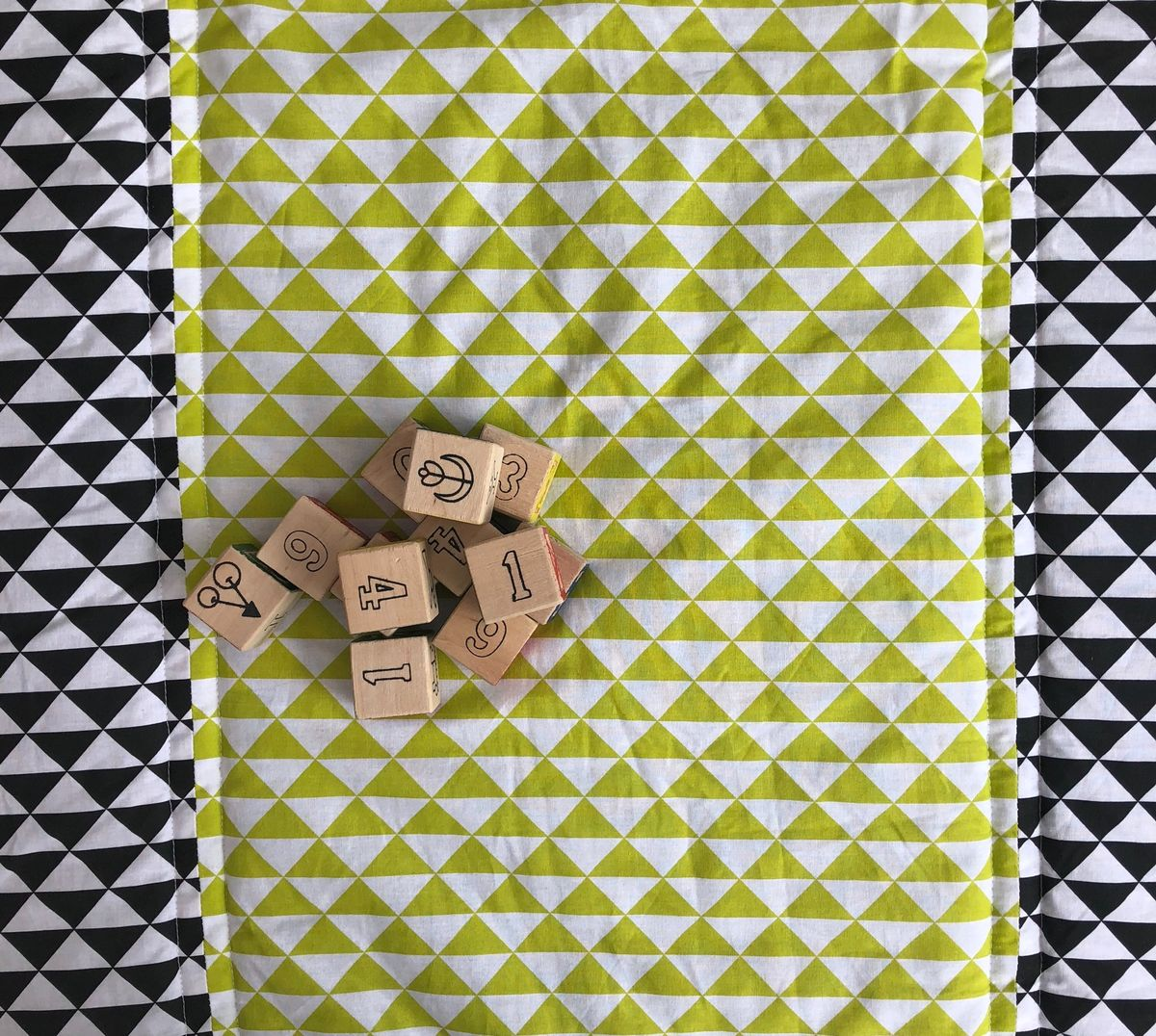 Contemporary geometric patterned quilted baby play mat, monochrome and lime green - product images  of