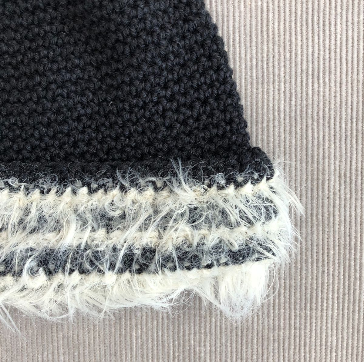 Black baby/toddler beanie hat with cream fur effect brim - product images  of