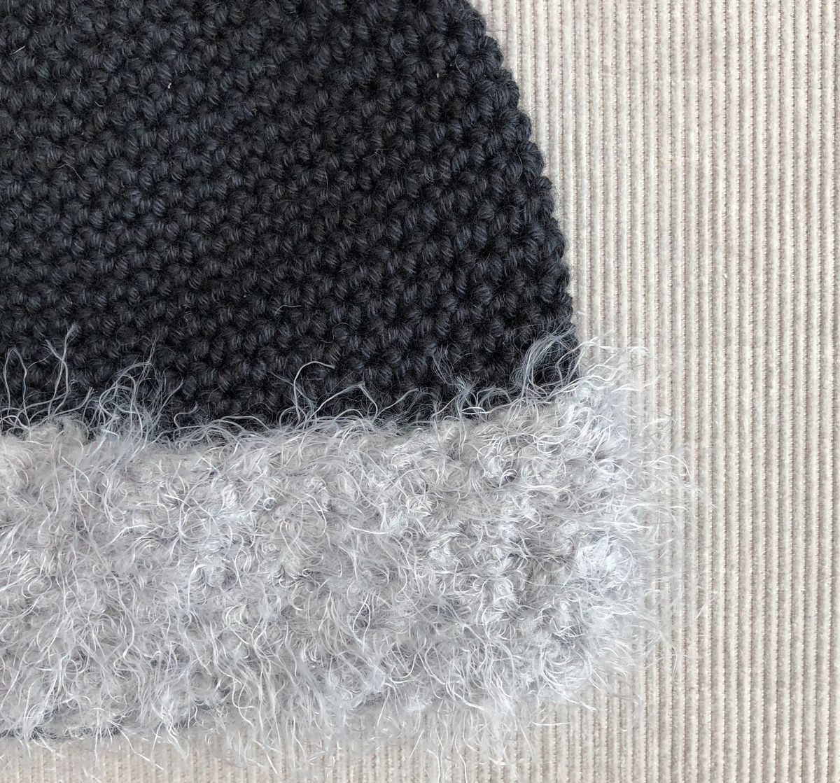 Black baby/toddler beanie hat with grey fur effect brim - product images  of