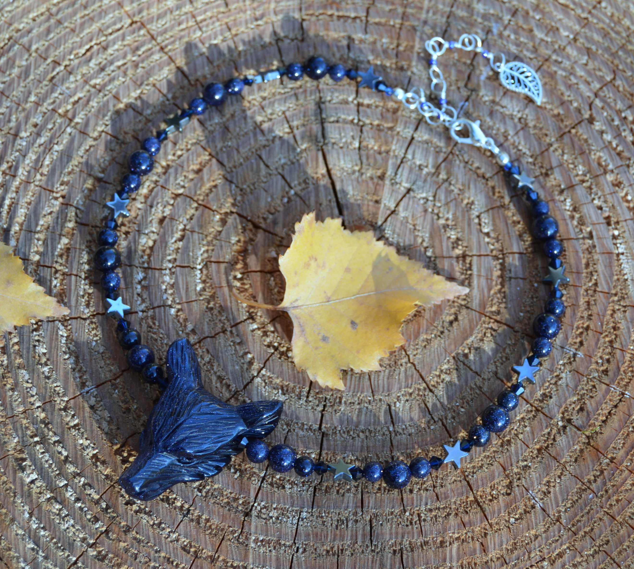 Blue Sandstone Goldstone wolf necklace with stars and indigo Swarovski crystals by Herisson Rose