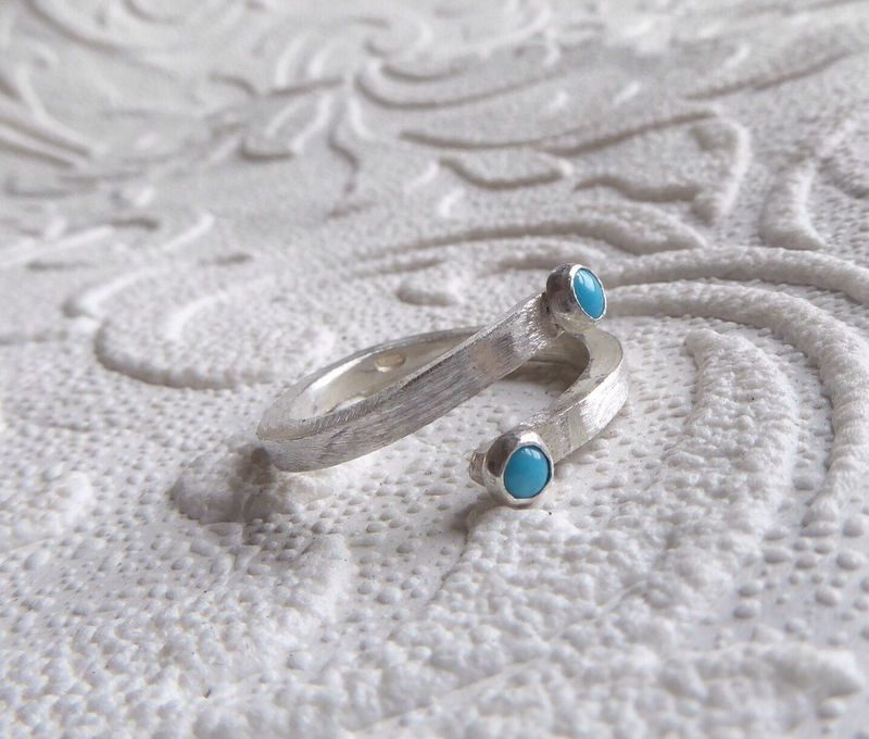 You and Me Sterling silver open crossover ring with turquoise cabochon gemstones - product images  of