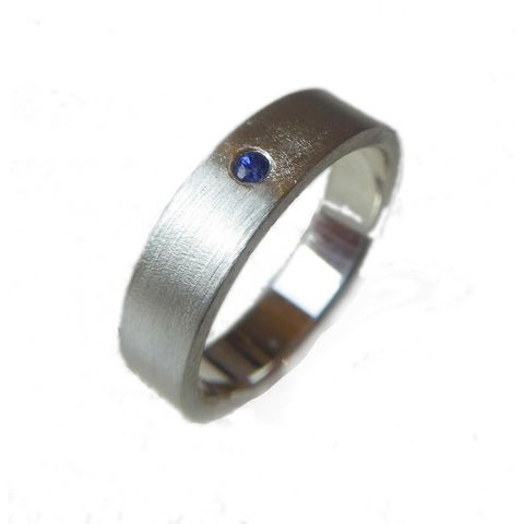 Blue,Sapphire,Silver,Band,for,Him,blue sapphire ring, blue sapphire wedding ring, matte silver wedding ring, jewellery for men, wedding ring for men, unusual rings for him, catherine marche sustainable jewellery