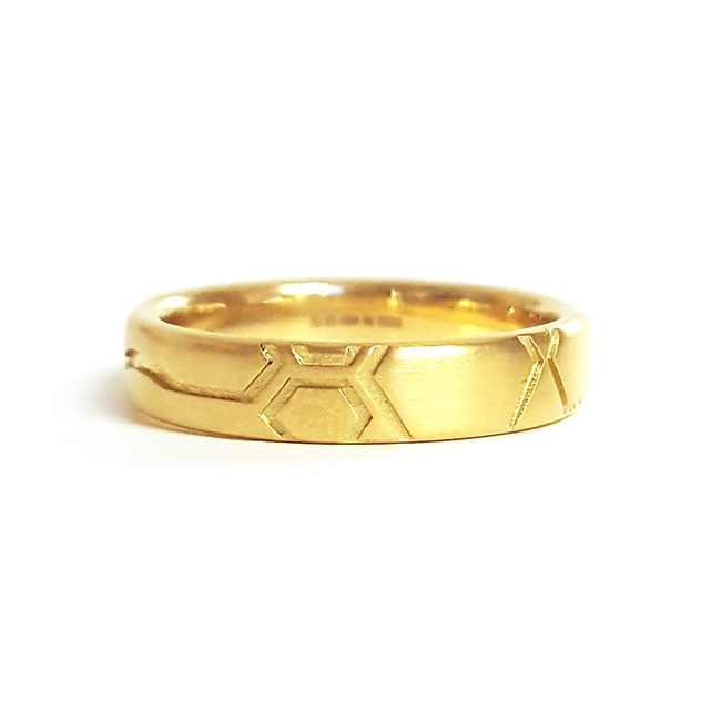 mens yellow gold wedding ring with geometric pattern