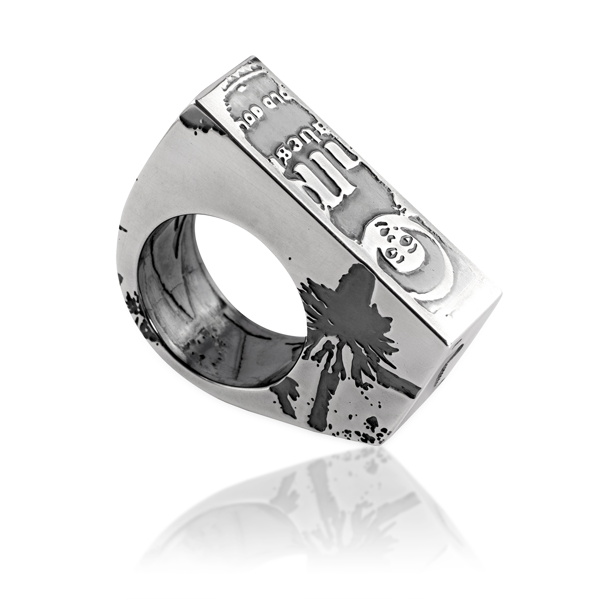 bespoke silver statement ring with etched images