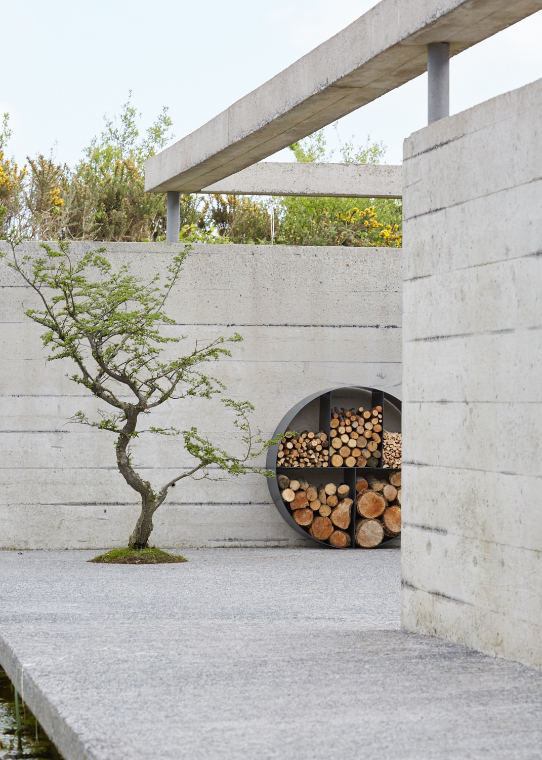Contemporary round metal log store in South Wales turning log storage into something much more stylish.
