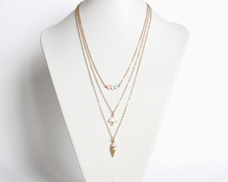 Layered necklace set (pastel blue, pink and white on hearts, umbrella and ice cream pendants) - product images  of