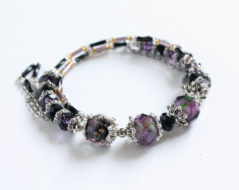 Plum,Purple,and,Black,Lampwork,Glass,Bead,Memory,Wire,Bangle,memory wire bangle, memory wire bracelet, plum purple black bangle bracelet, plum purple black memory wire bracelet, purple lampwork bracelet, black lampwork bracelet, black and purple bracelet, faceted lampwork bracelet