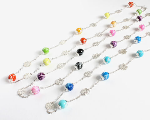 Random,Pattern,Beads,with,Silver,Roses,Long,Necklace,long beaded necklace, large bead necklace, bead and chain necklace, blue beaded necklace, silver rose necklace, colored bead and flower necklace, random pattern beads necklace, painted pattern beads necklace, rainbow beads necklace