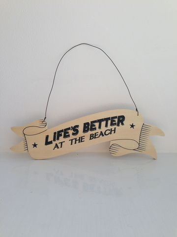Lifes,Better,at,the,Beach,Plywood,Ribbon,Sign,by,East,of,India,Lifes Better at the Beach Plywood Ribbon Sign by East of India