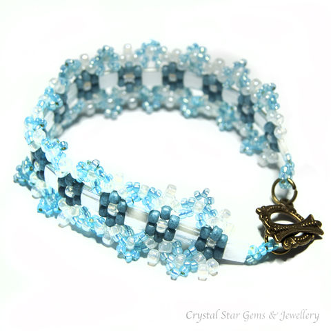 Pale,Blue,and,White,Aztec,Daisy,Bracelet,bracelet, beaded, beadwork, pale blue, white, aztec daisy, daisy