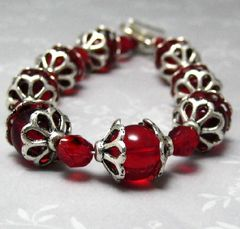 Handmade,Ruby,Red,Glass,and,Silver,Bracelet,Jewelry,Beaded,handmade_bracelet,ruby_red_crystals,heart_toggle_clasp,romantic,romance,formal,elegant,silver_heart,red_and_silver,seven_inches,silverriverjewelry,red_glass_bracelet,glass,czech_glass,silver_plated_bead_caps,silver_plated_heart_tog