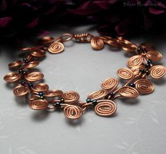 Copper,Egyptian,Coil,Bracelet,with,Dark,Metallic,Seed,Beads,Jewelry,Wire_Wrapped,egyptian_coil,coppper_wire,handmade_bracelet,dark_metallic_beads,sleek,elgant,organic,silver_river_jewelry,copper_wire,seed_beads