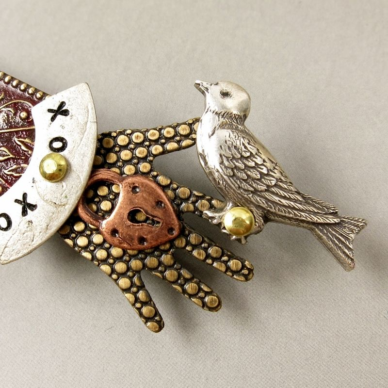 Mullanium - Bird in Hand Pin with Brown Tone - product image